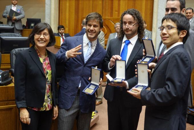 Paulina Bocaz, NRAO/AUI legal representative in Chile; Hugo Messias; Alejandro Sáez; Akihiko Hirota. Credit: N. Lira - ALMA (ESO/NAOJ/NRAO)
